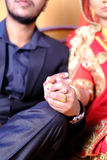 Close up of Indian bride and groom holding hands after the wedding ceremony Stock Photography