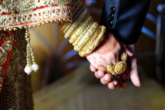 Close up of Indian bride and groom holding hands after the wedding ceremony Royalty Free Stock Photography
