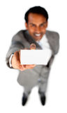 Close up of an indian businessman showing a card Stock Images