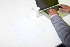 Close up of Indian mans hands typing on laptop Stock Photo