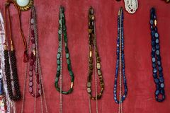 Close up Indian souvenirs and beads. Closeup image of different colorful souvenirs in Indian market with metal figures of Indian goddess Stock Images