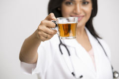 Close up of Indian young doctor with black tea Royalty Free Stock Photo
