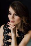 Close up. Individuality. Thoughtful Elegant Lady in Black Prom Evening Dress. Studio retouched photo. Royalty Free Stock Photo