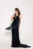 Close up. Individuality. Thoughtful Elegant Lady in Black Prom Evening Dress. Studio retouched photo. Royalty Free Stock Image