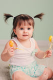 Close up indoor portrait of cute happy baby girl playing with easter decorations Royalty Free Stock Photo