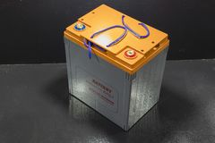 Close up industrial battery. Shown in shelf ; golf cart battery royalty free stock images