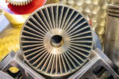 Close up industrial casting parts vane pump or propeller blades gold color or brass.  stock image