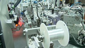 Close up on industrial production line for small parts, robotic arms stock footage