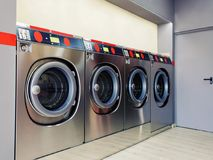 Self service washing machine with clean space. Close up of industrial self service washing machine with digital display and coin insert space royalty free stock photos