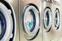Self service washing machine close-up. Close up of industrial self service washing machine with digital display and coin insert space Stock Photography