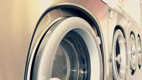 Self service washing machine working. Close up of industrial self service washing machine working stock video footage