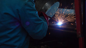 Close up industrial worker welding argon at workshop.  Royalty Free Stock Image
