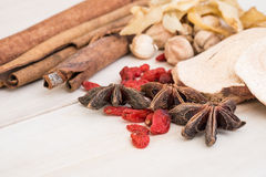 Close up of Ingredients for Chinese herbal soup on wooden backgr Stock Photos