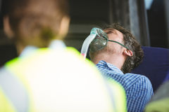 Close-up of an injured man wearing oxygen mask Stock Images