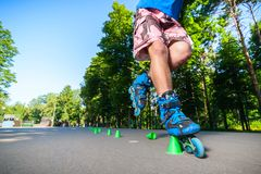 Inline roller skater on a slalom course Royalty Free Stock Photos