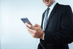 Close up of an innovative smartphone. Modern technological device. Close up of an innovative smartphone being used by a nice pleasant handsome businessman for Stock Images