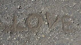 Close up of inscription love on pebble beach, free copyspace Royalty Free Stock Images