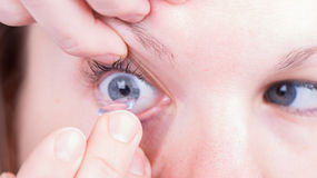 Close up of inserting a contact lens Royalty Free Stock Photo