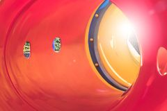 Free Close Up Inside Colorful Tunnel Slider With Sunlight In Playground At Public Park. Royalty Free Stock Photography - 145359127