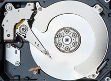 Close up inside of computer hard disk drive Royalty Free Stock Photos