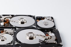 Close up inside of computer hard disk drive HDD on white backgro Stock Photo