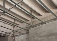 C-line aluminum ceiling structure work. Close up installation c-line aluminum ceiling structure work Royalty Free Stock Photo