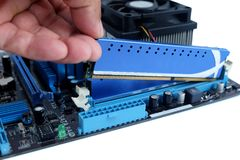 Close up installing ram and motherboard royalty free stock image