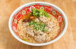 Close up of Instant noodle with meat ball and green Coriander on wood table. Close up of Instant noodle with meat ball and green Coriander stock image