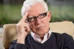 Close-up of intelligent elder man. Wearing glasses Royalty Free Stock Photo