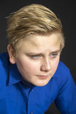 Close up of intense blond youth Royalty Free Stock Photography