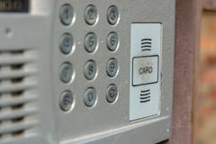 Close up of intercom in the entry of a house. Closeup of grey door entry device on front door Royalty Free Stock Image