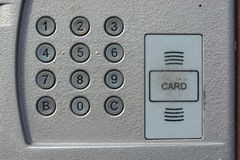 Close up of intercom in the entry of a house. Closeup of grey door entry device on front door Stock Photo