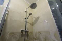 Close up of interior of new luxurious modern shower cabin with l. Ight beige ceramic tiling on walls stock images