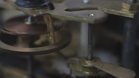 Close up of a internal clock mechanism. Vintage Watch Gears Movement Macro. Old vintage clock mechanism working, closeup shot with soft focus. Close up of a stock footage