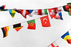 Close up of international flags garland decoration. International symbolics and unity concept - close up of national flags garland decoration Royalty Free Stock Photography