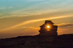 Close-up of Inukshuk  stones on ocean shore at sunset Royalty Free Stock Photos