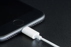 Close-up iPhone 7 matte black connect to usb cable Royalty Free Stock Images