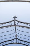 Close up of  Iron fence. Close-up of metal fence  on blue background Royalty Free Stock Photo