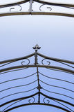 Close up of  Iron fence. Close-up of metal fence  on blue background Stock Photos