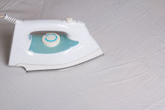 Close up of iron ironing cotton linen Stock Photography