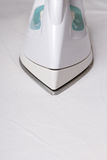 Close up of iron ironing linen Royalty Free Stock Images