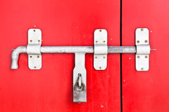 Close up Iron lock on the red door Stock Images