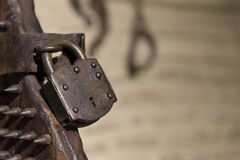 Close-up of iron padlock of ancient torture chair in sunlight Royalty Free Stock Photos