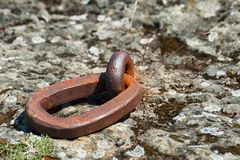 Close up of Iron Ring embedded in rock. Close up of a iron ring embedded in the rock along the shores of the Columbia River in The Dalles, Oregon.   These rings Royalty Free Stock Photos
