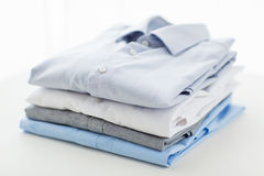 Close up of ironed and folded shirts on table Stock Photography
