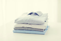 Close up of ironed and folded shirts on table Royalty Free Stock Images