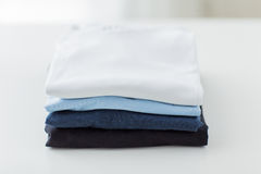 Close up of ironed and folded t-shirts on table Stock Photography