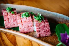Ishigaki beef wagyu A5 premium grade Sushi. Close up Ishigaki beef wagyu A5 premium grade Sushi at local restaurant, Okinawa, Japan Royalty Free Stock Image