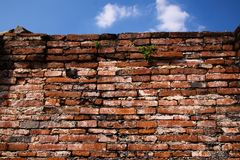 Close up of isolated ancient brick walls with blue sky in Ayutthaya near Bangkok, Thailand stock photography