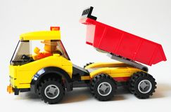 Close up isolated kids toy truck against white background. Colourful isolated kids toy truck with wheels and a driver inside royalty free stock photography
